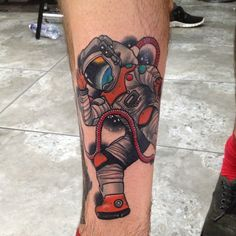 Astronaut outer space tattoo by Dan Molloy.