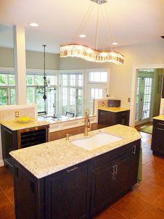 kitchen remodel, wine fridge, island, tile floor, tile back splash, crystal chandelier, built in bench