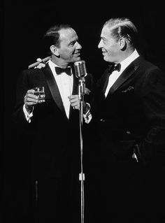 Frank Sinatra and Milton Berle onstage at the 1960 Share, Inc. party, photographed by David Sutton