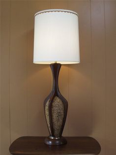 DANISH MODERN Cork Brass Walnut Table Lamp Light A stunning Mid Century Danish Modern cork lamp. This lamp offers a very unique design, it has a beautiful walnut sculptured wood design surrounding the cork vessel and resting on a nice walnut base. In nice condition with some finish wear to the brass accents and a …
