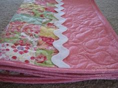 "Make quick baby girl quilts for upcoming baby showers with this Magic Jelly Roll Quilt. This baby quilt pattern will make bright and cheery baby quilts with ""magic"" cutting and piecing that you can finish in just a few hours. Baby Quilt Tutorials, Beginner Quilt Patterns, Quilting Tutorials, Quilting Projects, Quilting Ideas, Free Tutorials, Sewing Projects, Sewing Tutorials, Beginner Quilting"