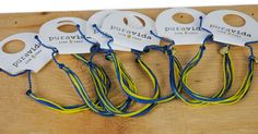 PURA VIDA BRACELET - BLUE ANGELS COLORS Custom Original Bracelet Yellow/Blue About Pura Vida: Pura Vida ` Live Free Founded in Costa Rica, each purchase helps provide full-time jobs for artisans worldwide.