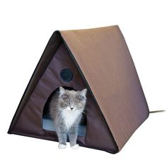 Outdoor Thermo Kitty A-Frame http://www.thatpetplace.com/outdoor-heated-kitty-a-frame-heated-chocolate-20-in-x-20-5-in-x-35-in?utm_content=buffer06278&utm_medium=social&utm_source=pinterest.com&utm_campaign=buffer @khpet | K&H Outdoor Heated Kitty House is the ideal shelter for your outdoor cat. Designed with waterproof fabric and a convenient overhang feature, the house will keep your cat dry and out of the rain. Large and roomy, the house can accommodate up to four cats and includes two entra…