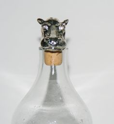 Handcrafted in South Africa, this unique African Hippo Cork Stopper/Bottle Stopper Hallmarked Sterling Silver, is vintage, authentic AfriSilver, purchased from the artist and stamped with the logo. This Hippo represents one of the South African Big 5, considered the five most powerful animals in Africa, the Rhino, Lion, Water Buffalo, Elephant, Leopard and the Lion. This sculptured Hippo cork stopper, will be a great addition to your decor and a good conversation piece as well as a coll...