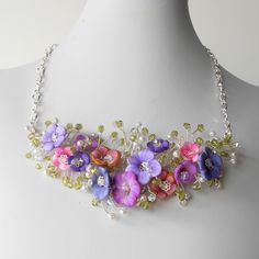 Beaded Necklace Beaded Twisted Wire Necklace with Pink and Purple Flowers on Silver Wire Bridal Jewelry. $93.00, via Etsy.