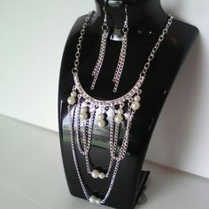 New silver multi chain necklace w/pearls set. Elegant silver longer necklace  with crystals and white faux pearls. Multiple chains dropping from main chain with white faux pearls.  Chain earrings included. Not for children's use.   So much prettier than picture shows. Great gift choice! Jewelry Necklaces
