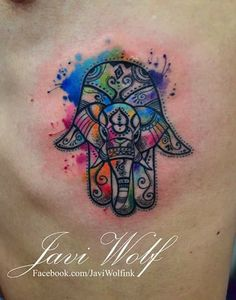 Hamsa hand and elephant watercolor tattoo from Javi Wolf