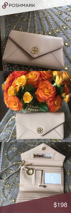 HPTory Burch Dark Sahara Robinson Clutch 7/13 Tory Burch Dark Sahara Robinson Clutch.  Beautiful Saffiano leather in this gorgeous color.  Perfect clutch to wear during day or night! Tory Burch Bags Clutches & Wristlets