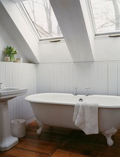 All I can think about when I look at this image is taking a bath in there during a rainstorm.  YES.