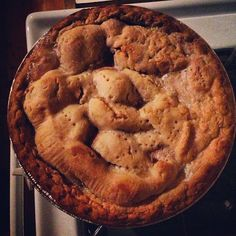 Apple Pie   2 (9-inch) pie crusts    2 tablespoons all-purpose flour  1 cup sugar  1/2 teaspoon ground cinnamon  1/4 teaspoon ground nutmeg 7-8 apples, peeled, cored & thinly sliced    1 tablespoon butter  Bake 375 degrees @ 45-55 minutes.  Serve with French vanilla ice cream.