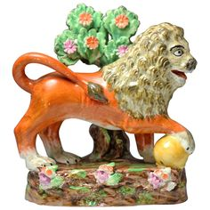 Antique English Pottery Sherratt Staffordshire Pearlware Figure of a Lion | From a unique collection of antique and modern pottery at http://www.1stdibs.com/furniture/dining-entertaining/pottery/