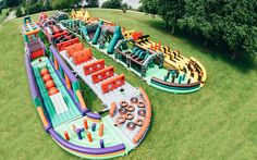 THE WORLDS BIGGEST INFLATABLE OBSTACLE COURSE!!! At a length of 893 feet and with 32 different inflatable parts, the world's biggest bouncing obstacle course is a childhood dream come true.