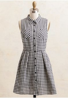 Twirl around in this pleasantly adorable dress featuring navy and ivory hues in an all over plaid print. With a collared neckline, functional pockets, button-up closure and a keyhole opening on t...