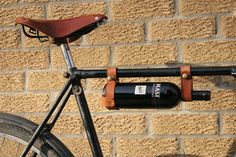 Bicycle Wine Rack - Tan Leather Bike Bottle Holder by oopsmark on Etsy https://www.etsy.com/listing/72559858/bicycle-wine-rack-tan-leather-bike