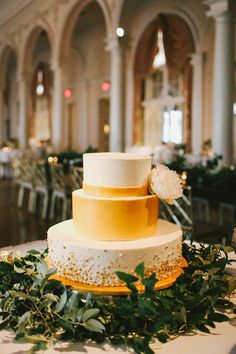 gold and white wedding cake - photo by w&e photographie http://ruffledblog.com/chic-wedding-at-an-atlanta-driving-club