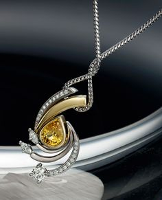 18k white and yellow gold sapphire and diamond pendant