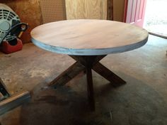DIY coffee table (but with concrete top like this: http://rogueengineer.com/diy-x-brace-side-table-concrete-top-plans/)
