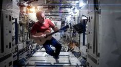 Astronaut Chris Hadfield playing David Bowie's Space Oddity aboard the space station. Canadian Chris cruising cool.