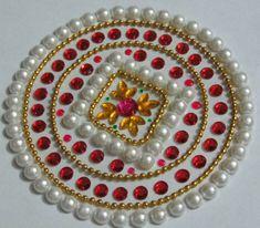beautiful moti kundan rangoli design