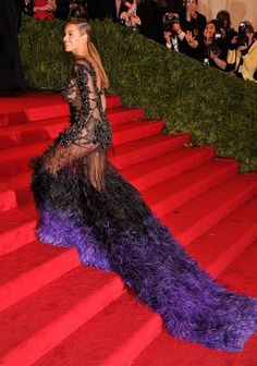 Last year, Beyoncé turned it out in a very, very sheer — feathered, embellished, and dramatic also apply here — Givenchy gown.