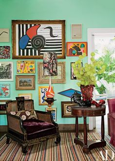 In the living room, art by Alexander Calder, Carla Barth, and others hangs behind a chinoiserie chair cushioned with a Rubelli velvet | archdigest.com