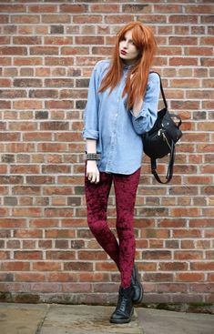 Shop this look for $120:  http://lookastic.com/women/looks/light-blue-shirt-and-burgundy-skinny-jeans-and-black-boots-and-black-backpack/948  — Light Blue Denim Shirt  — Burgundy Velvet Skinny Jeans  — Black Leather Boots  — Black Leather Backpack