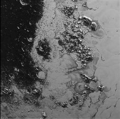 Newly-Discovered Mountains on Pluto Finally Have Those Missing Craters