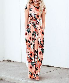 This standout dress features a bold floral design that adds feminine flair to your everyday wardrobe. Size S: 56'' long from high point of shoulder to hem95% polyester / 5% spandexHand wash; hang dryMade in the USA