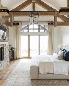 SM Ranch House: The Master Suite, pine ceiling wood beams, with shiplap, and black light fixture, make the most beautiful master bedroom ever. House Design, House, Home, Home Bedroom, Ranch House, House Inspo, Brick Exterior House, New Homes, Farmhouse Interior