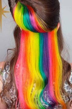 Hidden rainbow hair tresses allow you to be daring and switch to modest whenever you want. This versatile trend is great to experiment with.