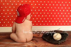 So have to do this with my grandson!   2 shots, both red-----one with a football & Razorback cap & one with baseball & Cardinals cap.