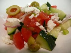 "Albanian Tomato Cucumber Salad from Food.com: This traditional salad is served throughout Albania. It is often served as first course. Typically this salad has equal proportions of tomato and cucumber. The rest of the ingredients are stictly added based on personal preference. I got this recipe from some missionaries that have lived in Albania for a long time. They made a cookbook with other missionaries called ""From bugs to beans."" Posted for ZWT 4."