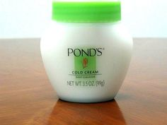 Ponds Cold Cream (Makeup Remover). Massage into your face, and wipe it off with a warm damp washcloth. Lasts a very long time and leaves your skin so soft! =) My mom's was in a milk glass jar with a metal lid.
