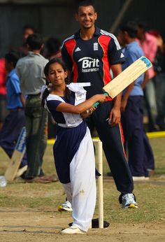 England player Ajmal Shahzad keeps wicket as a school girl plays a shot during a game of cricket during a visit by England players to promote the World Feeding Programme (WFP) in Bangladesh at the Sher-e-Bangla primary school on February 26, 2010 in Dhaka, Bangladesh.
