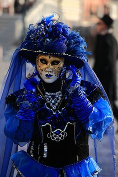 An amazing blue costume and a lovely, detailed mask.