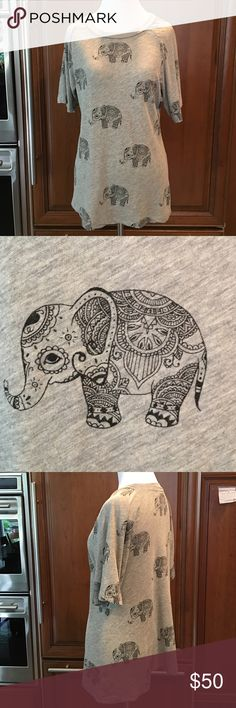 Wildfox Roaming Elephant T-Shirt Super soft and cute locker room gray tshirt with elephants roaming all over .  Gently worn with no flaws.  90%cotton 10% polyester.   ❤️❤️.  NO TRADES NO PYPL WILL NOT DISCUSS PRICE IN COMMENTS Wildfox Tops Tees - Short Sleeve