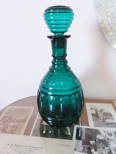 Vintage Green Glass Decanter, Shabby Chic Style...  ornate, beautiful and  perfect. $12.00, via Etsy.