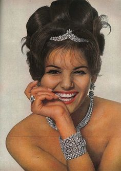 March Vogue 1962 Italian actress Claudia Cardinale is wearing an array of Van Cleef Arpels jewellery. Featured in the 'People are talking about..' column.