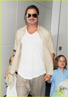 Angelina Jolie & Brad Pitt depart a flight out of Japan with their kids Pax, Vivienne, and Knox on July 30, 2013