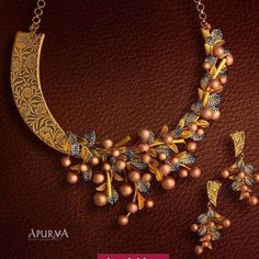 Limited Edition handcrafted necklace set in gold from the Apurva antique collection. Available at select Joyalukkas showrooms. Collier Antique, Gold Jewellery Design, Gold Jewelry, Jewellery Box, India Jewelry, Jewellery Shops, Jewellery Making, Antique Necklace, Jewelry Patterns