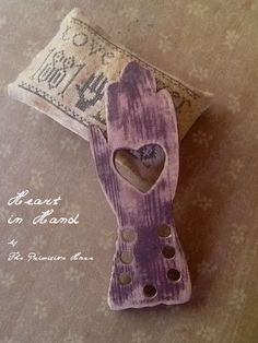 Heart in Hand Thread keeper by ThePrimitiveHare on Etsy, $16.50