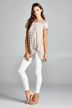 Jersey knit stripe top that is so comfy, chic and easy to wear! Throw on with jeans and a strappy heal for date night, or throw on with capris and sandals for a day look! We LOVE the front twist detail on this one! Also available in Mauve! True to size. Made in the USA. 95% Rayon Jersey, 5% Spandex