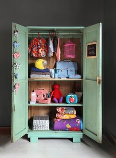 "I could see an armoire near the front door housing all the kids ""get out the door"" stuff - backbacks, boots, coats!"