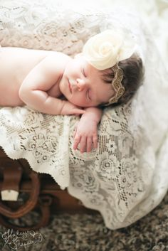 A vintage feel for your newborn with the perfect headband, lace and trunk.  Sweet, soft and precious.    The Photography of Haley Sheffield
