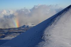 Mauna Kea Rainbow: With the heavy clouds below and the sun at my back, it was not surprising to see a rainbow (faintly doubled) from the 13,796' summit of Mauna Kea.   More surprising to me was how many snowboards/snowboarders there were in Hawaii.   Also very amusing was the incredible number of pickup trucks that came down the mountain filled with snow for snowman building back down at sea level.  For more images with commentary visit us at www.The-Digital-Picture.com/gallery/