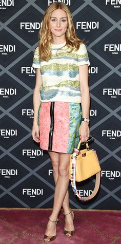Olivia Palermo's couture show attendance shows no sign of slowing down. She arrived at the Fendi fall 2015 couture show in a sparkly wavy-striped tee that she expertly paired with a pink-and-lime mix zip-front Markus Lupfer mini and accessorized with a mustard yellow top-handle mini purse and bronze ankle-strap peep-toes.