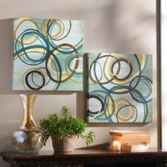 Idea multiple different sized canvases and circles that bleed from one to the other canvas