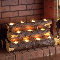 Safe Flickering Tealight Fire Logs - place this inventive log sculpture right in the fireplace and watch its smart design provide an enchanted, no-fuss substitute for a real fire. Handcrafted from durable resin so it's totally safe and holds 11 included tea lights.