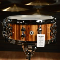 "Sonor 14x7 Pacific Walnut Burl One Of A Kind Snare Drum This 14""x7"" One of a Kind Snare drum is built from an 15-ply 10mm Beech Shell, with an exclusive Pacific Walnut Burl Veneer. SONOR purchases a s"