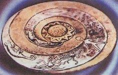 This plate called 'The Lolladoff plate' is a 12,000 year old stone dish found in Nepal. It clearly shows a disk shaped UFO (top of pic, hard to see from the angle of the plate however). There is also a figure on the disc looking remarkably similar to a Grey alien. Notice the spiral galaxy shape as well, with the alien inside it and the ufo at the beginning of it.